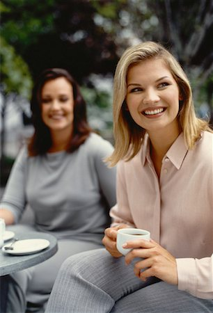Two Women Holding Mugs at Outdoor Cafe Stock Photo - Rights-Managed, Code: 700-00054052