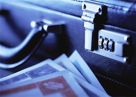 Close-Up of Briefcase and Stock Certificates Stock Photo - Rights-Managed, Code: 700-00055064