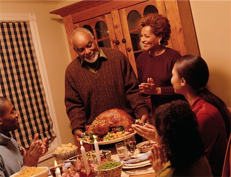Grandfather Bringing Turkey to Thanksgiving Dinner Table Stock Photo - Rights-Managed, Code: 700-00055597