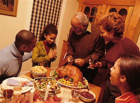 Grandfather Carving Turkey at Thanksgiving Dinner Table Stock Photo - Rights-Managed, Code: 700-00055598
