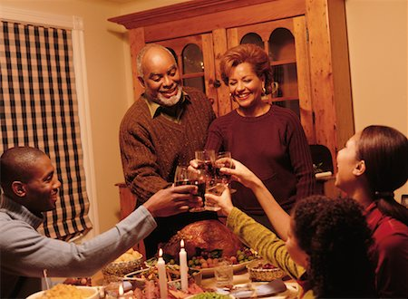 Family Toasting with Glasses at Thanksgiving Dinner Table Stock Photo - Rights-Managed, Code: 700-00055599
