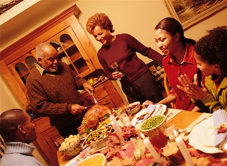 Grandfather Carving Turkey at Thanksgiving Dinner Table Stock Photo - Rights-Managed, Code: 700-00055666