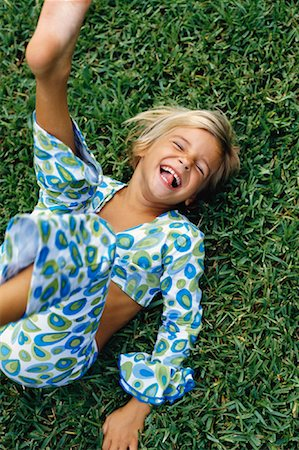 preteen girl feet - Girl Lying on Grass, Laughing Stock Photo - Rights-Managed, Code: 700-00055795