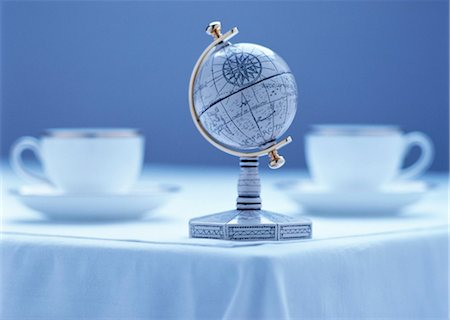 Globe on Corner of Table with Cups Stock Photo - Rights-Managed, Code: 700-00056880