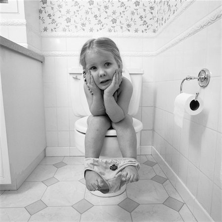 Portrait of Girl Sitting on Toilet Stock Photo - Rights-Managed, Code: 700-00058346