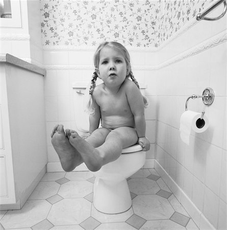 Portrait of Girl Sitting on Toilet Stock Photo - Rights-Managed, Code: 700-00058347