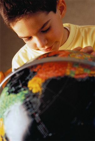 Close-Up of Boy Looking at Globe Stock Photo - Rights-Managed, Code: 700-00059211