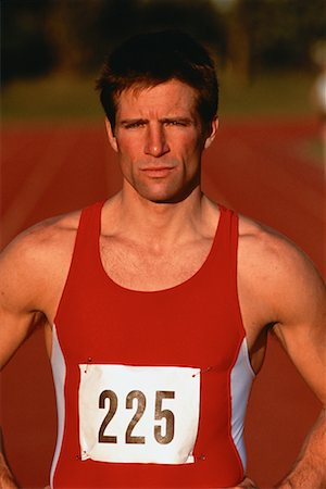 peter griffith - Portrait of Male Runner Standing On Outdoor Track Stock Photo - Rights-Managed, Code: 700-00053092