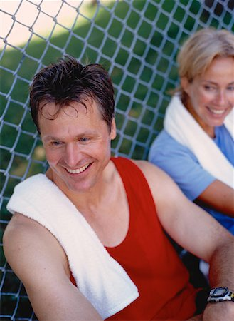 sweaty woman - Mature Couple Resting in Park After Workout Stock Photo - Rights-Managed, Code: 700-00053362