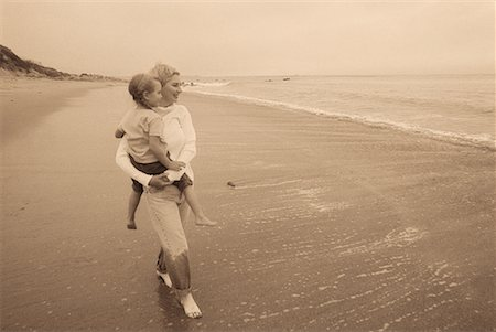 peter griffith - Grandmother Carrying Granddaughter in Surf on Beach Stock Photo - Rights-Managed, Code: 700-00064748