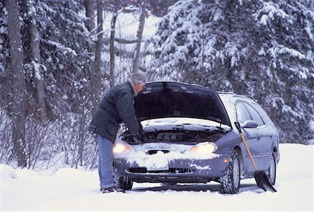 Mature Man with Stalled Car at Roadside in Winter, ON, Canada Stock Photo - Rights-Managed, Code: 700-00065024