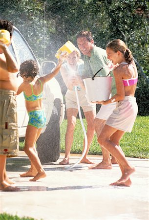 Family Washing Car, Having Water Fight Stock Photo - Rights-Managed, Code: 700-00065610