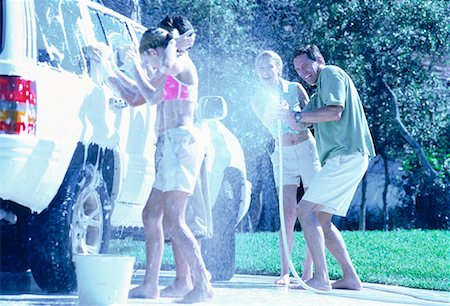 Family Washing Car, Having Water Fight Stock Photo - Rights-Managed, Code: 700-00065611