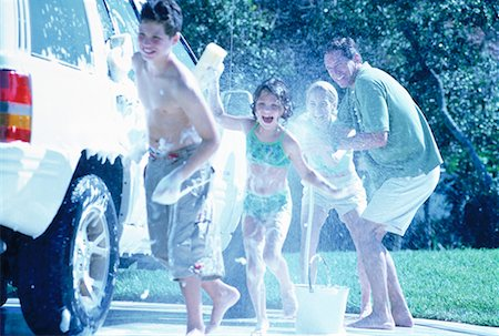 Family Washing Car, Having Water Fight Stock Photo - Rights-Managed, Code: 700-00065613