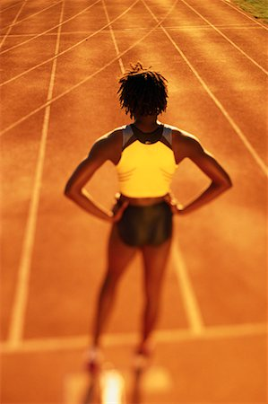 Back View of Female Runner Standing on Track Stock Photo - Rights-Managed, Code: 700-00066924