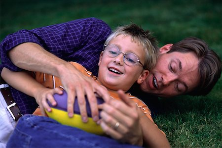 peter griffith - Father and Son Playing with Football Outdoors Stock Photo - Rights-Managed, Code: 700-00067008