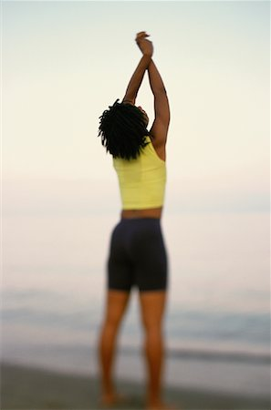 Back View of Young Woman Standing On Beach, Stretching Stock Photo - Rights-Managed, Code: 700-00067064