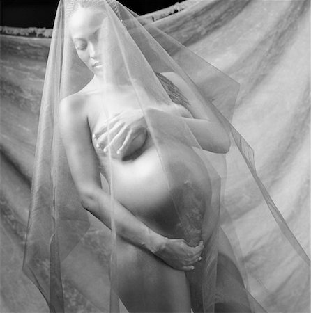 Portrait of Nude Pregnant Woman Under Sheer Fabric Stock Photo - Rights-Managed, Code: 700-00067617