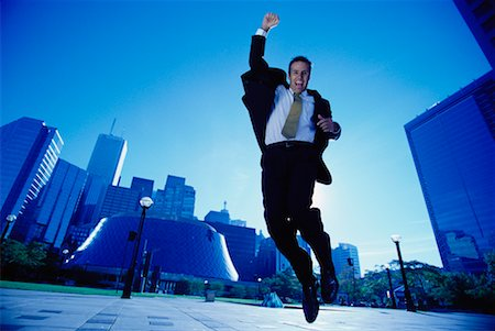 peter griffith - Ecstatic Businessman Jumping in Air, Toronto, Ontario, Canada Stock Photo - Rights-Managed, Code: 700-00068439