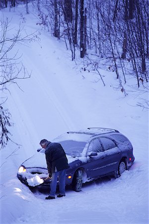Mature Man Shovelling Snow in Front of Car Stock Photo - Rights-Managed, Code: 700-00069905