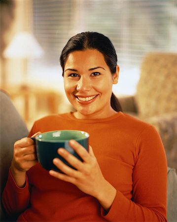 peter griffith - Portrait of Woman Sitting on Sofa Holding Mug Stock Photo - Rights-Managed, Code: 700-00060112