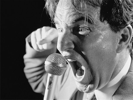 sweaty businessman - Businessman Screaming into Microphone, Perspiring Stock Photo - Rights-Managed, Code: 700-00061170