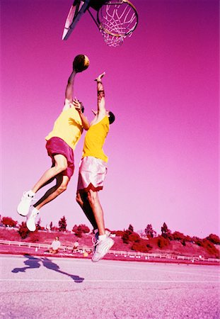 peter griffith - Two Men Playing Basketball Jumping in Air Outdoors Stock Photo - Rights-Managed, Code: 700-00062694