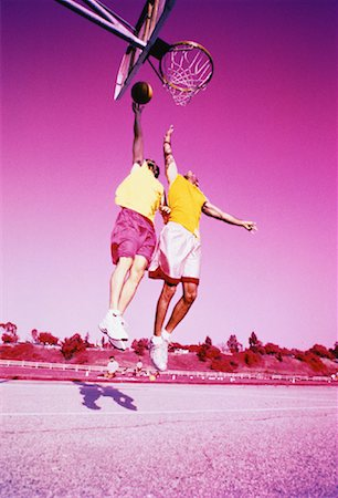 peter griffith - Two Men Playing Basketball Jumping in Air Outdoors Stock Photo - Rights-Managed, Code: 700-00062693