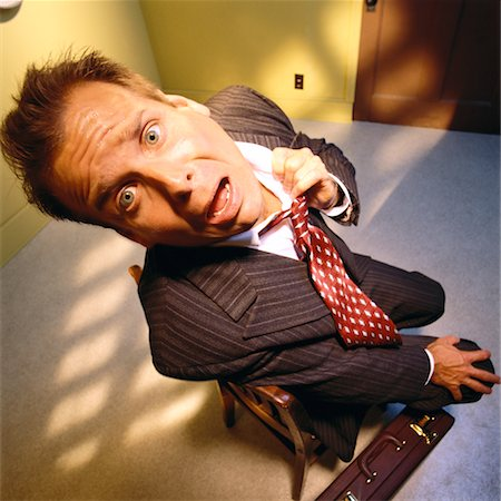 sweaty businessman - Portrait of Worried Businessman Loosening Tie Stock Photo - Rights-Managed, Code: 700-00063532