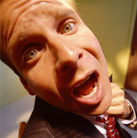 sweaty businessman - Close-Up of Worried Businessman Loosening Tie Stock Photo - Rights-Managed, Code: 700-00063533