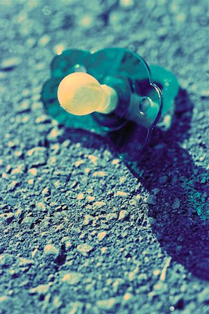 Pacifier on Ground Stock Photo - Rights-Managed, Code: 700-00063690