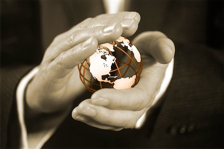 Close-Up of Businessman's Hands Holding Wire Globe North America Stock Photo - Rights-Managed, Code: 700-00076320