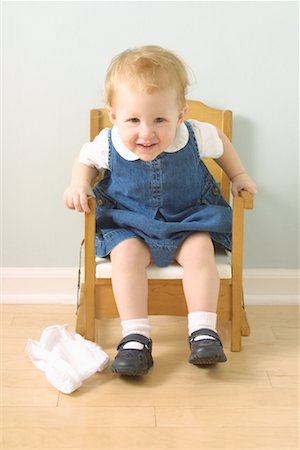 Girl Sitting in Potty Chair Stock Photo - Rights-Managed, Code: 700-00077311