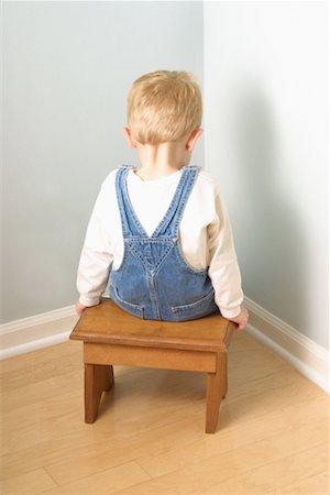 Back View of Boy Sitting in Corner Stock Photo - Rights-Managed, Code: 700-00078437