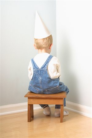 Back View of Boy Sitting in Corner Stock Photo - Rights-Managed, Code: 700-00078438
