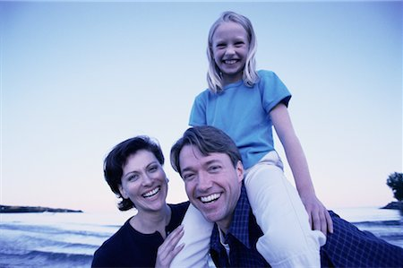 peter griffith - Portrait of Family with Daughter On Father's Shoulders Outdoors Stock Photo - Rights-Managed, Code: 700-00070306