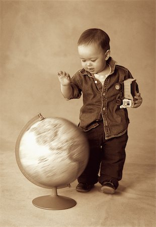 Boy Standing near Spinning Globe Stock Photo - Rights-Managed, Code: 700-00070704