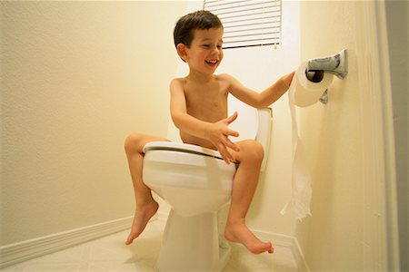 Nude Boy Sitting on Toilet Unrolling Toilet Paper Stock Photo - Rights-Managed, Code: 700-00070918