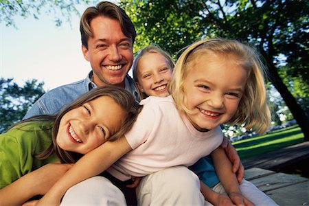 peter griffith - Father with Daughters, Laughing Outdoors Stock Photo - Rights-Managed, Code: 700-00071632