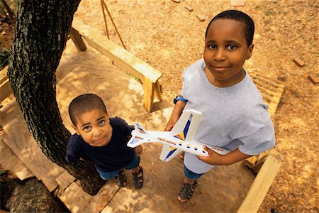 pre-teen boy models - Portrait of Two Boys Standing on Treehouse, Holding Toy Airplane Stock Photo - Rights-Managed, Code: 700-00085427