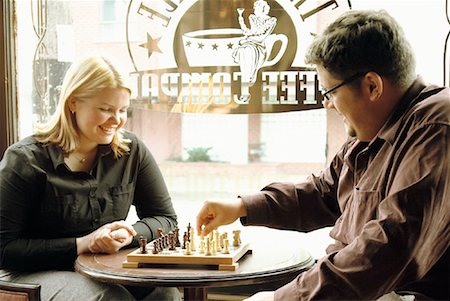 Couple Sitting in Cafe, Playing Chess Stock Photo - Rights-Managed, Code: 700-00085659