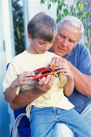 pre-teen boy models - Grandfather and Grandson Playing With Model Hot-Rod Outdoors Stock Photo - Rights-Managed, Code: 700-00086256