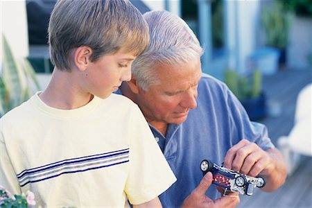 pre-teen boy models - Grandfather and Grandson Playing With Model Hot-Rod Outdoors Stock Photo - Rights-Managed, Code: 700-00086257