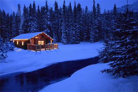 Log Cabin by Stream in Winter At Dusk Stock Photo - Rights-Managed, Code: 700-00086537