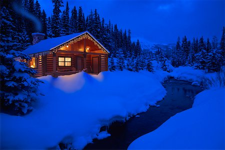 Log Cabin by Stream in Winter At Dusk Stock Photo - Rights-Managed, Code: 700-00086539