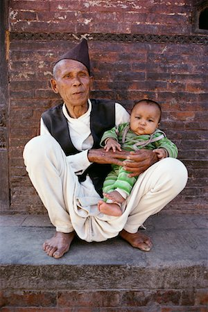 Portrait of Mature Man with Baby Kathmandu Valley, Nepal Stock Photo - Rights-Managed, Code: 700-00086650