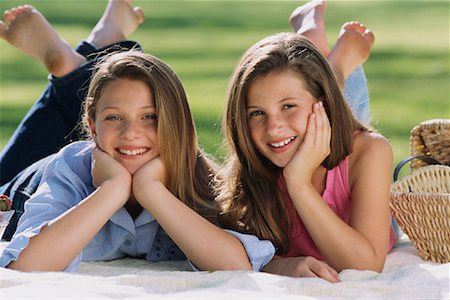 Portrait of Two Girls Lying on Blanket Outdoors Stock Photo - Rights-Managed, Code: 700-00086687