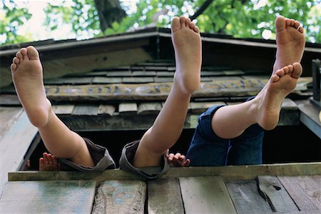 preteen girl feet - Feet Hanging From Tree House Stock Photo - Rights-Managed, Code: 700-00088199
