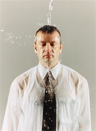 sweaty businessman - Water Falling on Businessman Stock Photo - Rights-Managed, Code: 700-00088934