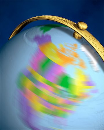 Blurred View of Globe Spinning On Stand North America Stock Photo - Rights-Managed, Code: 700-00080719